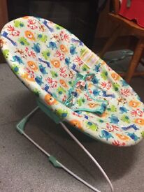 Baby bouncy chair with animal print cotton cover