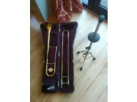 Trombone with case and stand.