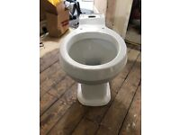 Brand new toilet with cistern and seat