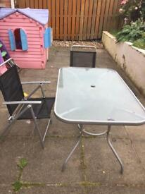 SOLD.Garden table and 6 chairs