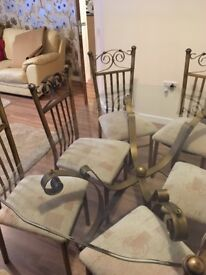 Need gone! Glass dining table with 6 chairs