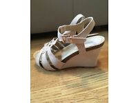 Woman's nude/beige wedge sandal size 5