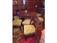 Extending Oval Mahogany dining table with 6 chairs