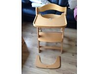 Wooden high chair/kids chair with adjustable foot plate and seat.
