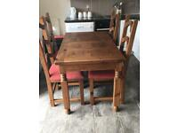 Dark oak dining table and table