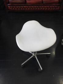 White hairdressing saddle stool