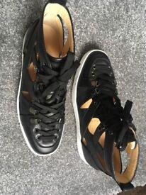 Christian Louboutin Man shoes. Classic sneakers.