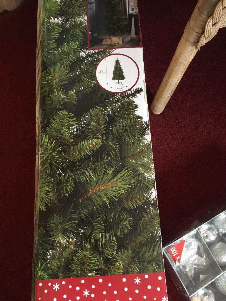 5ft green xmas tree with stand box of 100 silver baubles a box of xmas lights never been used