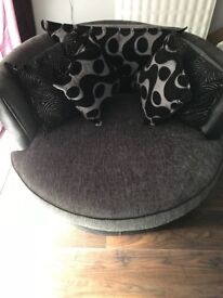 DFS Swivel Chair, like new. Grey and black with cushions