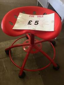 Small red swivel chair