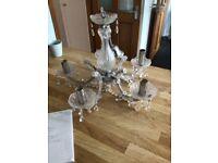 1 clear glass chandelier + 1 rose gold light habitat.
