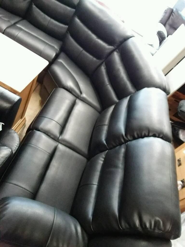 Black leather corner sofa recliner