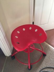 Red stool on wheels