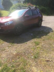 Red Nissan Qashqai +2 available for sale