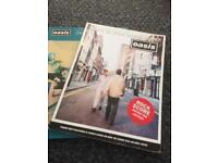 Oasis Rock score guitar bass tab books x2. Definitely maybe, what's the story.