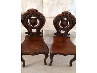 A matched pair of repro shieldback oak chairs