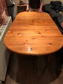 Solid oak extending dining table with 4 chairs.
