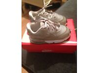 Silver Nike trainers