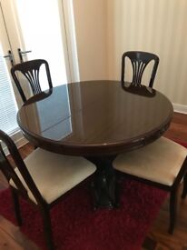 Solid mahogany dining table and 4 chairs, must be uplifted