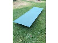 used pair of green camp beds