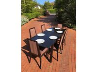 Extendable dining table + 6 chairs. Black, solid wood, frame with black glass top