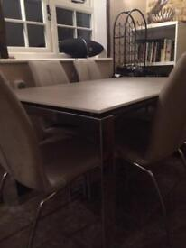 Fishpools dining table with 6 chairs