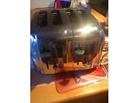 Russell Hobbs 4 slice toaster and Tesco kettle (USED )...in good working condition.