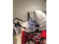 White pram complete with carry cot seat unit and car seat