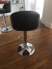 Set of 4 black bar stools. Chrome with gas lift