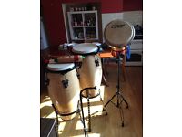Set of Congas and a Jembe drum all with stands plus brass chimes and onother percussion instrament