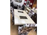Cream and brown engineered marble dining table
