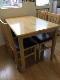 Solid wooden table & 4 chairs!