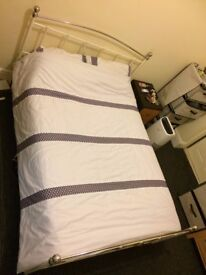 Double bed with mattress and bedsheet