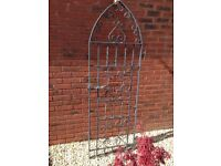 Wrought iron garden gate.