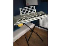 Yamaha E303 keyboard. Fabulous 61 key soft touch key. Many features. Adjustable stand included