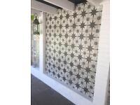 Ceramic Tiles including Adhesive
