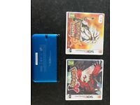 Nintendo 3DS blue with Pokemon sun and pokemon y.