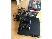 PS3 with 16 games, 2 control pads & camera
