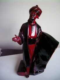 Royal Doulton Flambe Figurine 'The Carpet Seller' . This is the standing version.