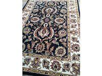 Hand tufted oriental rug.