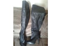 Branded black long boots size 4