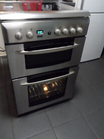gas cooker 60cm double oven in excellent condition in stainless steel , not very old.