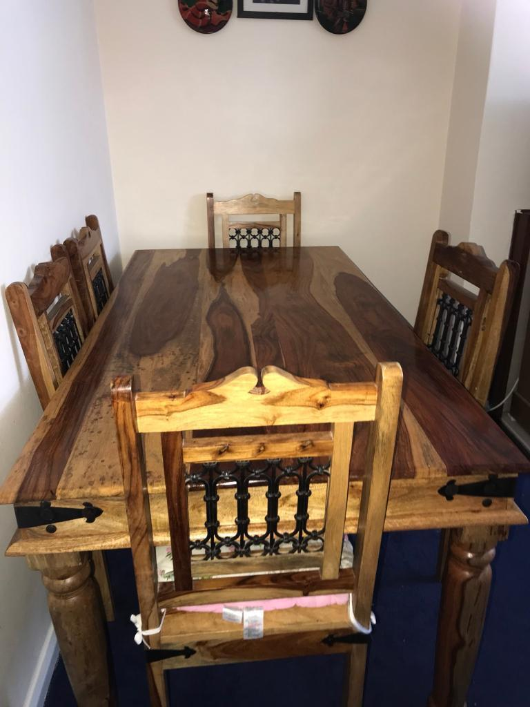 Wooden dining table in good condition for sale.