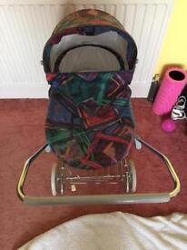 Toy Pram with extra doll clothes and accessories