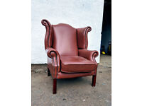 Brown leather chesterfield chair