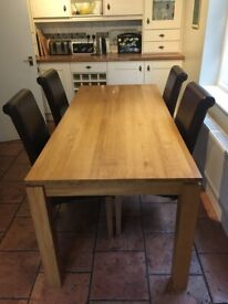 Oak dining table with 4 leather chairs