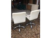 Two Cream Leather Hydraulic Chairs on Casters