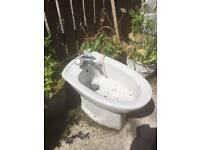 BIDET WITH TAPS AND FITTINGS