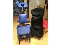 Massage chair and carry case with wheels and stand.