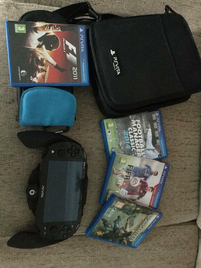 Ps vita slim, 4 games, 4gb memory card, 2 cases and grip controller.